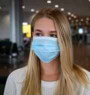 En kvinna med munskydd. Henrik Montgomery/TT / TT NYHETSBYRÅN