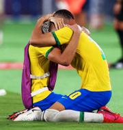 Brasilianska spelarna jublar.  Bildbyrån.