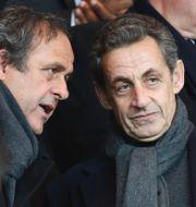 Platini och Nicolas Sarkozy. Michel Euler / TT NYHETSBYRÅN