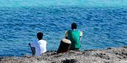 Migranter på den italienska ön Lampedusa. Antonio Calanni / TT NYHETSBYRÅN/ NTB Scanpix